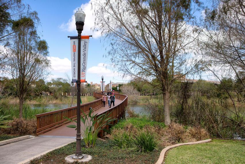 Students cross a bridge at the University of Texas Rio Grande Valley campus in Brownsville.