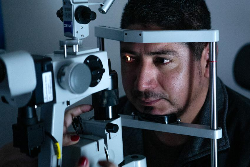 Dr. Noor Abushagur uses a slit lamp, a microscope used to examine the inner and outer structures of the eye, to make sure El…