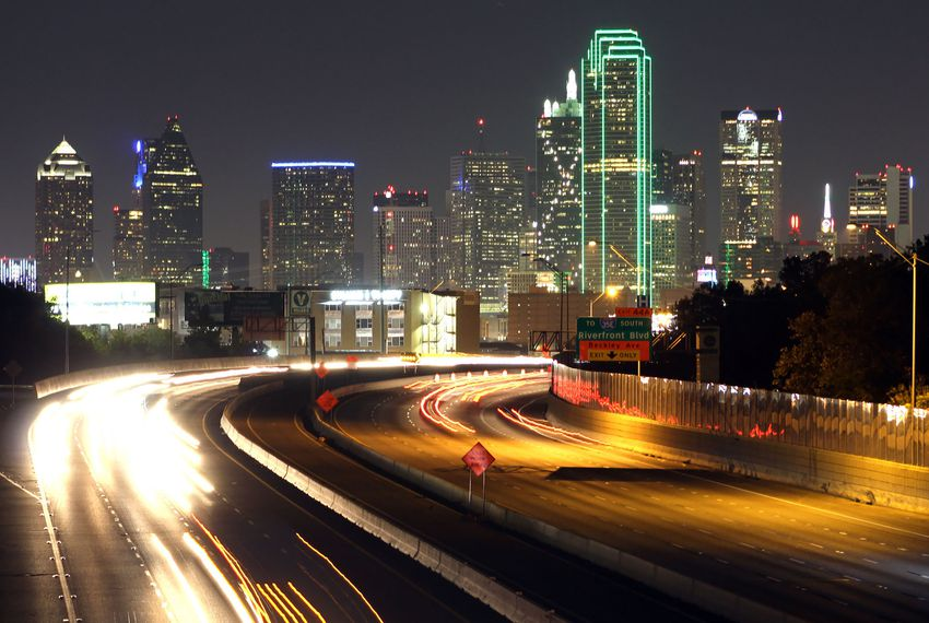 Traffic moves along Interstate 30 east of downtown Dallas.