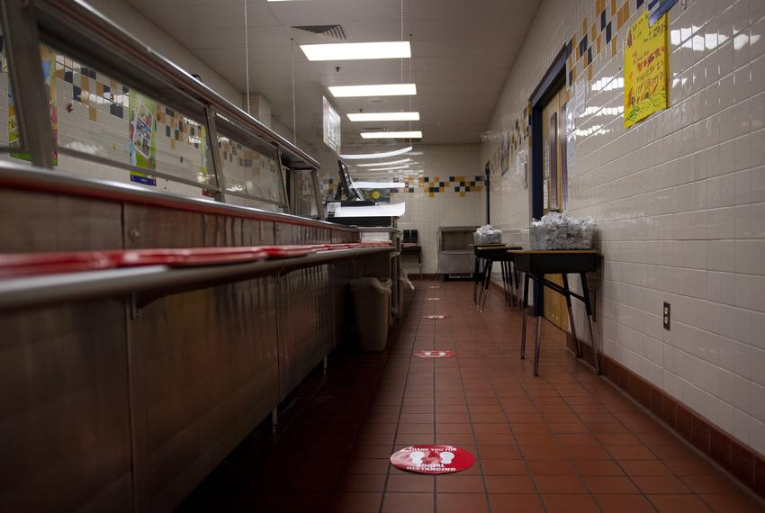 Social distancing decals are posted on the floor in the cafeteria line at Ott Elementary School on Tuesday, Aug. 11, 2020 in…