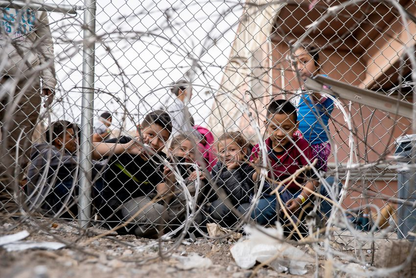 A group of kids are seen inside a temporary migrant holding area set up by Customs and Border Protection under the Paso del Norte International Port of Entry between Juarez and El Paso, on March 27, 2019.