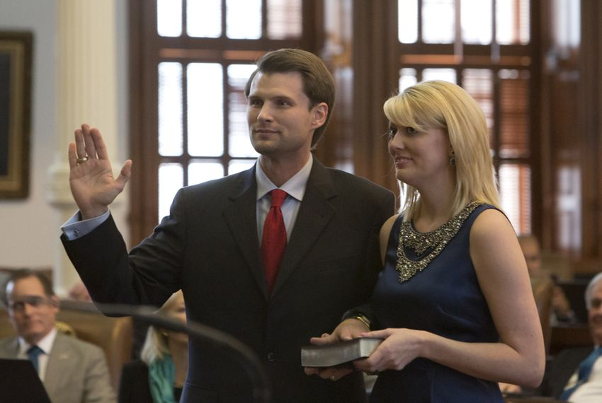 Leighton Schubert R-La Grange as he is sworn-in as Texas Representative for district #331 on March 3rd, 2015.Next to him is his wife Brittany