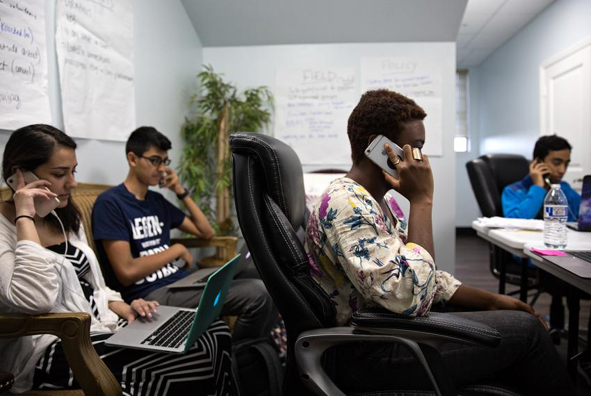 Campaign volunteers for Sri Kulkarni, a Democrat vying to unseat U.S. Rep. Pete Olson, R-Sugar Land, work the phones before …