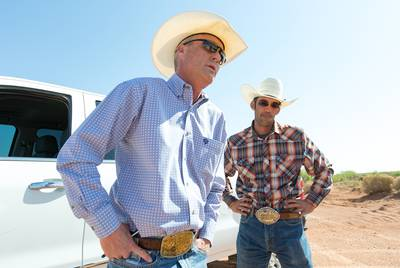 Wayne Smith (foreground) and business partner J.W. Todd, pictured on May 24, 2018, have objected to the way the federal government manages oil production on public land that ranchers also lease in southeastern New Mexico.
