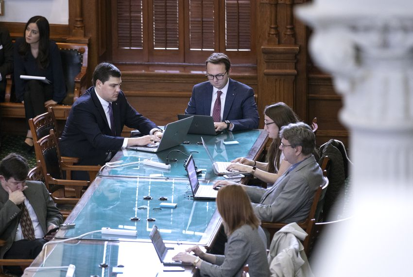 Destin Sensky and Brandon Waltens, employees of Texas Scorecard, a product of the influential political group Empower Texans, sit at the Texas Senate press table.