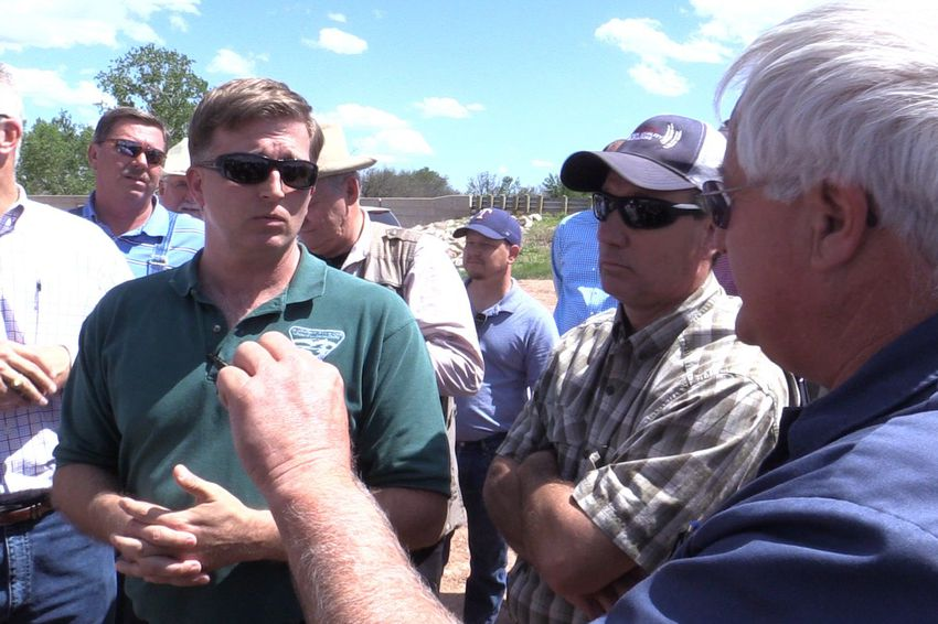 Federal Bureau of Land Management spokesman, Paul McGuire, attempts to answer questions from a barrage of property owners in Clay County on Monday.