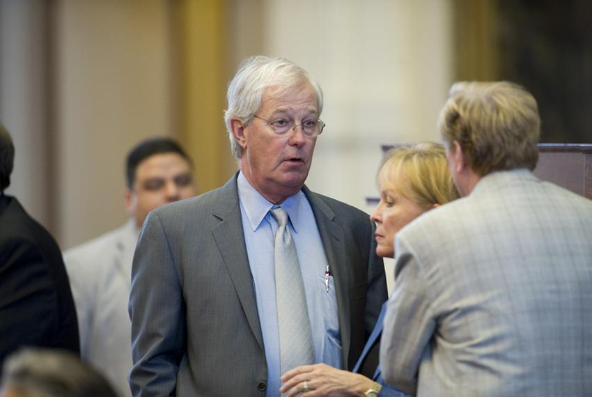 State Rep. Charlie Geren, R-Fort Worth, talks with colleagues on the floor during discussion on school finance Friday aftern…