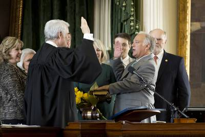 State Sen. Kirk Watson, R-Austin, is sworn in as Senate president pro tempore by Texas Supreme Court Chief Justice Nathan Hecht. Looking on are Sen. Jane Nelson, R-Flower Mound (far left), and Robert Nichols, R- Jacksonville (far right).