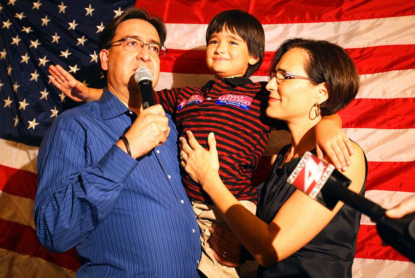 Pete Gallego makes his acceptance speech accompanied by his wife, Maria Elena and son, Nicolas, 8,  during the district 23...