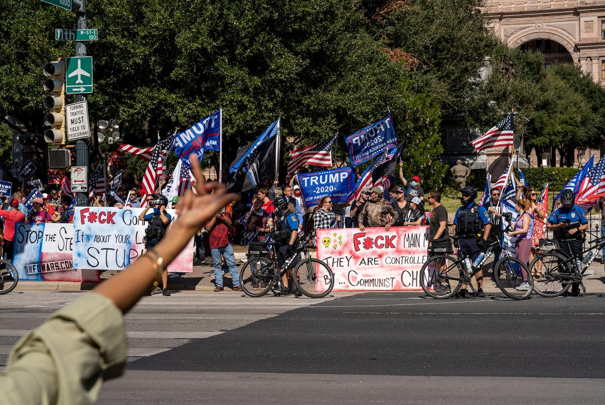 Supporters of President Donald Trump gather in front of the state Capitol Building for a