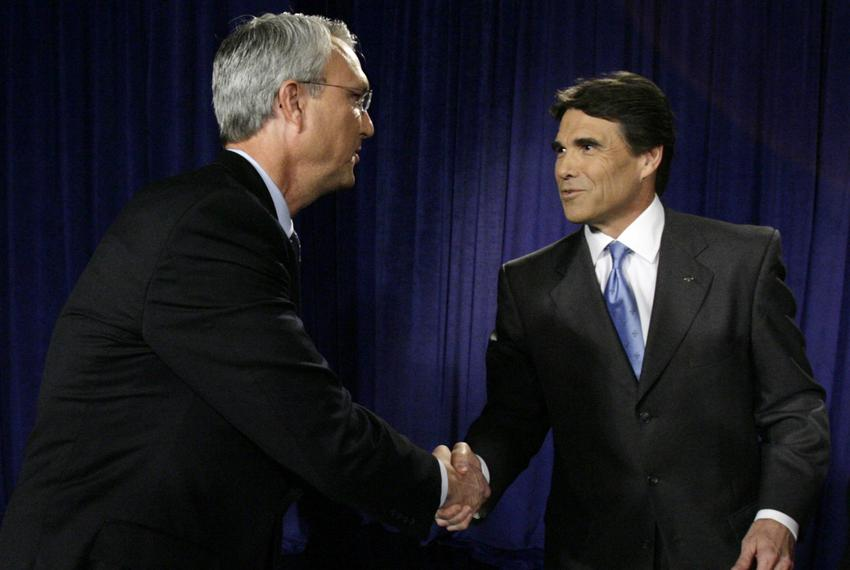 From left, Democratic gubernatorial candidate Chris Bell greets Gov. Rick Perry, prior to the start of a on-air debate in Da…
