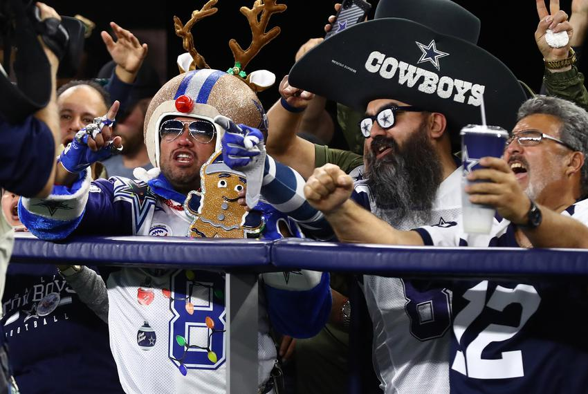 Dallas Cowboys fans cheer during the second half against the Los Angeles Rams at AT&T Stadium.