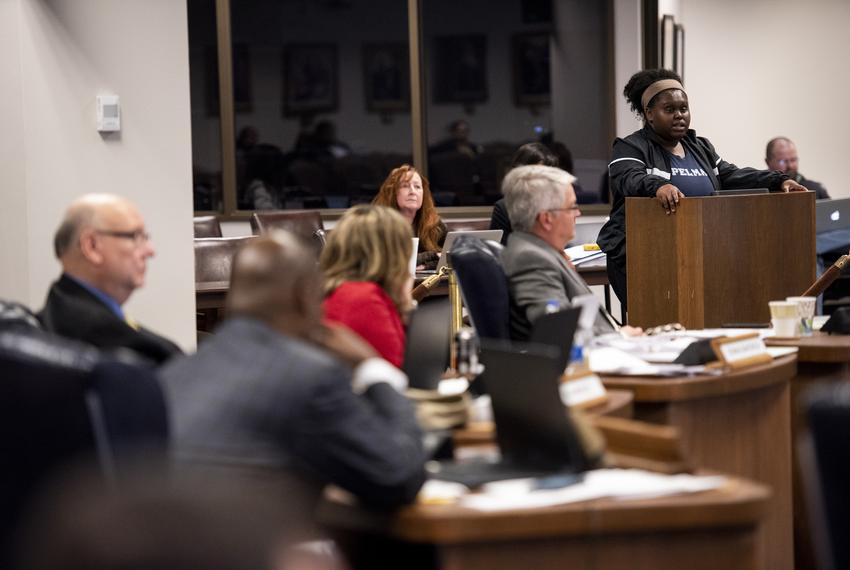 Masters of Education Policy student Chloe White testifies in support of a proposed addition to a high school African Ameri...