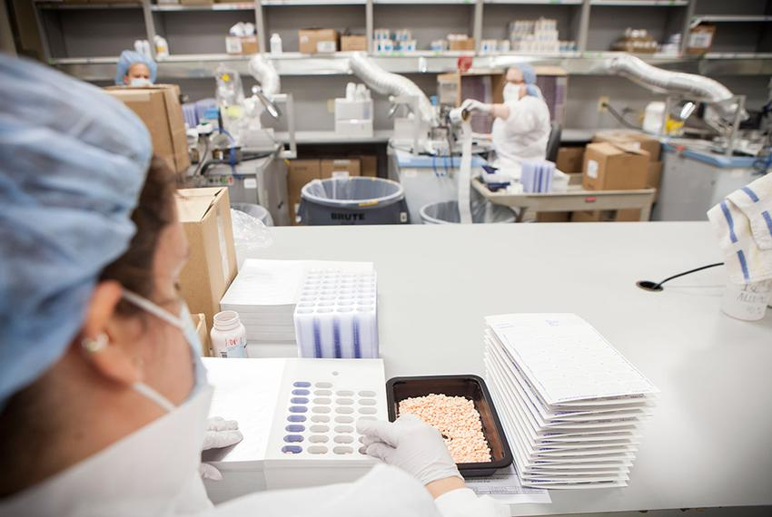 A pharmacy technician loads pills into punch cards at the Texas Department of Criminal Justice's pharmacy in Huntsville on W…