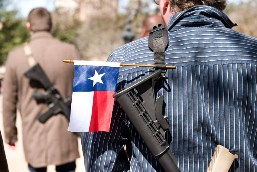 Gun rights supporters participate in an open carry march during South by Southwest led by the Austin chapter of Come and Take It on March 12, 2014.