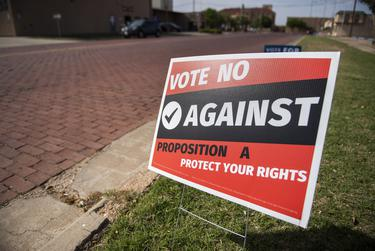 A sign opposing a proposed city ordinance that would ban abortions inside Lubbock city limits outside of an early voting location on April 27, 2021, in Lubbock. Known as Proposition A, the ordinance goes to a public vote on the May 1 election.