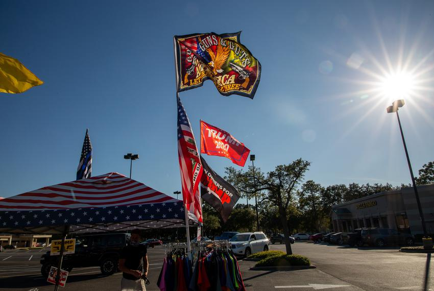 Flags wave on Election Day at a merchandise stand in Kingwood owned by resident Homer Price.
