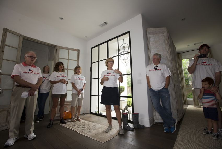 Lisa Luby Ryan, Republican candidate for Texas House District 114, talks to volunteers and supporters inside her home ahead of a block walk in the Lake Highlands neighborhood of Dallas on Sept. 22, 2018.