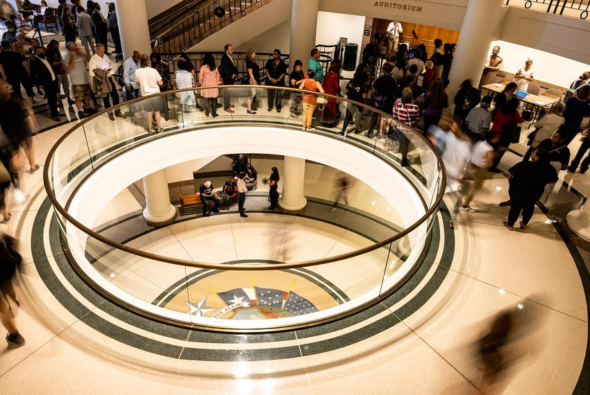 Hundreds of people wait outside an Auditorium in the Capitol extension to provide testimony at a Senate committee hearing re…