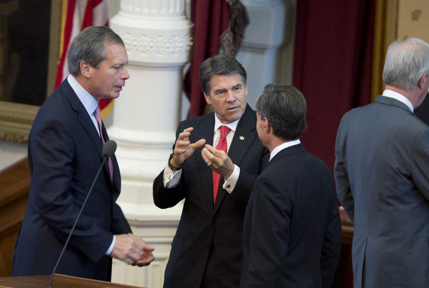 Lt. Gov. David Dewhurst, l, Gov. Rick Perry and House Speaker Joe Straus confer after the Texas Fallen Heroes Memorial Cerem…