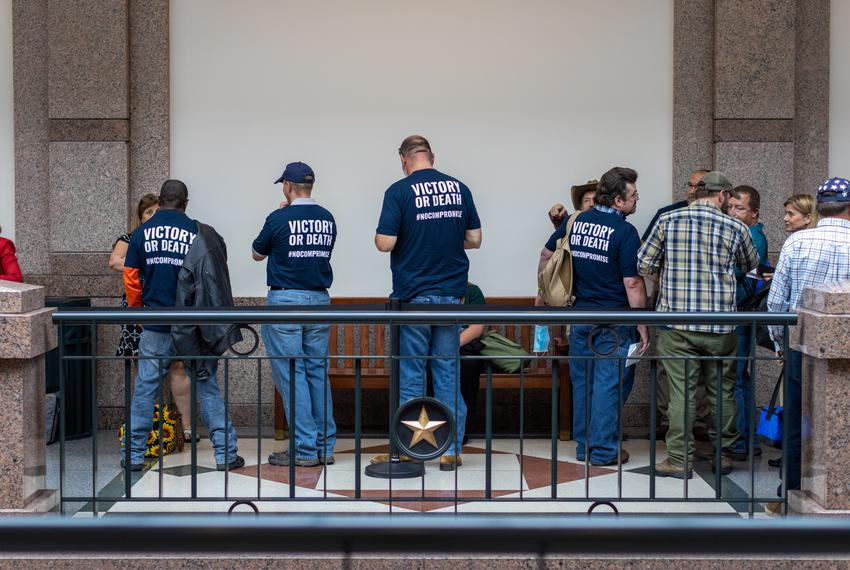 Gun rights advocates wait to testify at a Senate committee hearing regarding the permitless carry of handguns on April 29, 2…