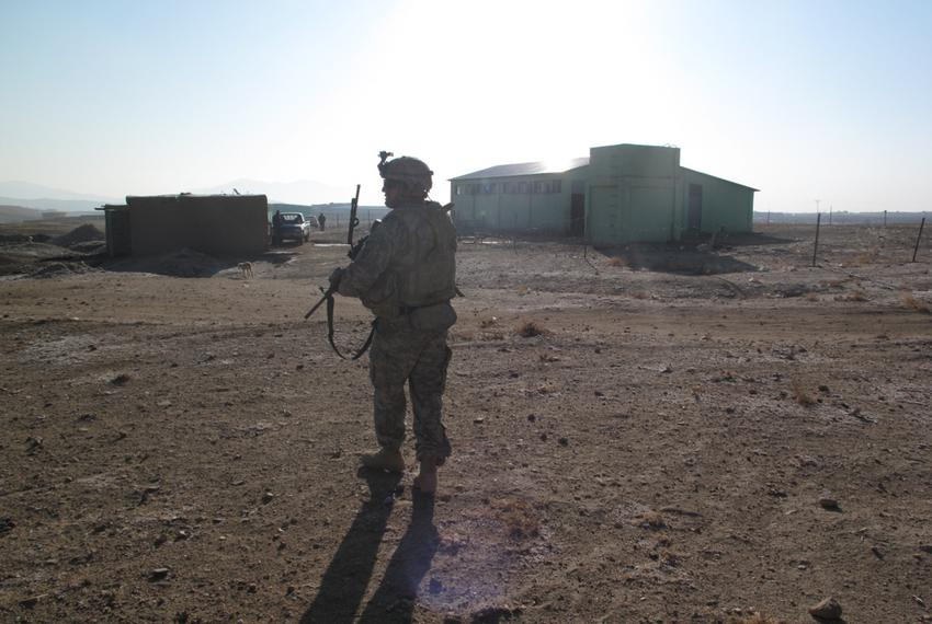 An ADT security soldier stands guard at the livestock facility, so the agricultural specialists can check out the new constr…
