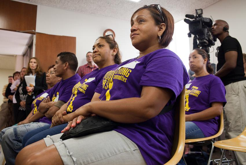 Jessinia Romero, center, listens as clergy joined janitors and supporters during a press conference to express interfaith le…