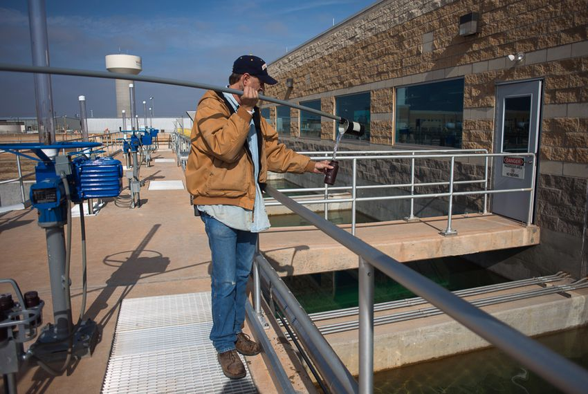 A plant employee, Charles Cupp, takes water samples at the Cypress Water Treatment Plant in Wichita Falls, on Friday, January 25, 2013.  This plant is responsible for the membrane reverse osmosis process being used on the city's water supply.  The city estimates that it's total water reserves are hovering around the 40 percent mark as of this year forcing it to begin implementing it's stage 3 emergency water restrictions and furthering steps toward increasing its water reclamation initiative.