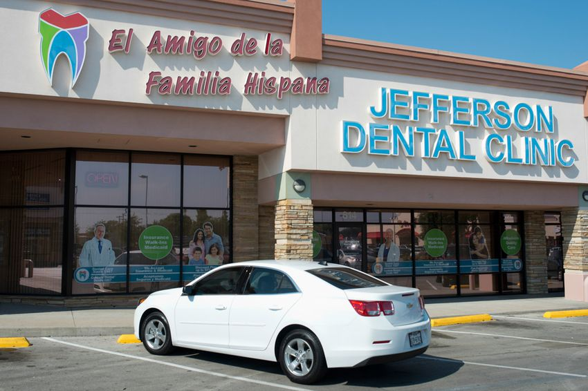 """A nod to the city's changing demographics, the masthead for a branch of Jefferson Dental Clinics in Irving, Texas includes a large Spanish-language sign on its storefront that reads, """"A friend of the Hispanic family."""""""