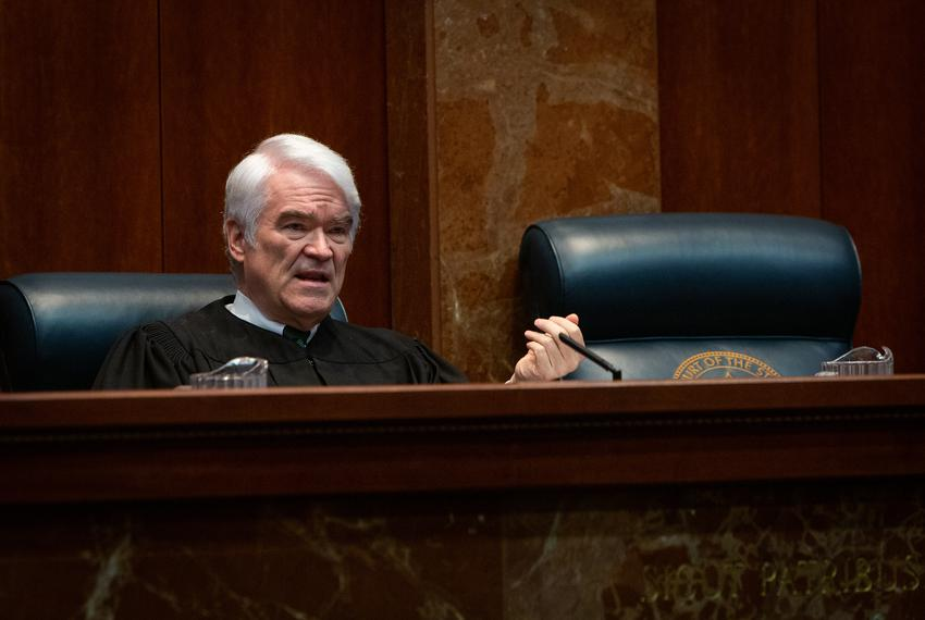 Texas Supreme Court Chief Justice Nathan Hect speaks during the hearing of the Texas Department of Criminal Justice v. Mau...