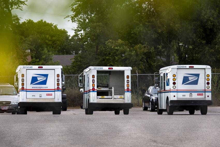 U.S. Postal Service trucks at an Austin office location on Aug. 17, 2020.