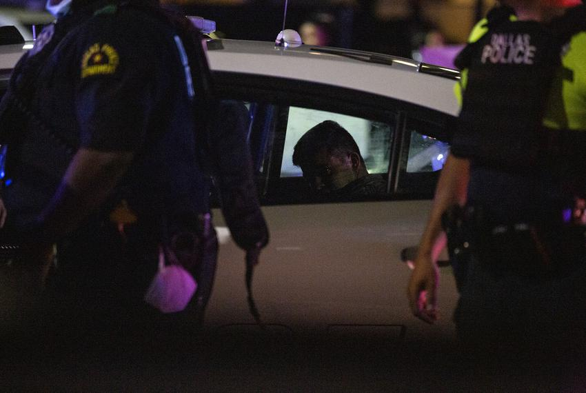 A protester is arrested by Dallas police at a march against the deaths of George Floyd and Breonna Taylor in Dallas on May 2…