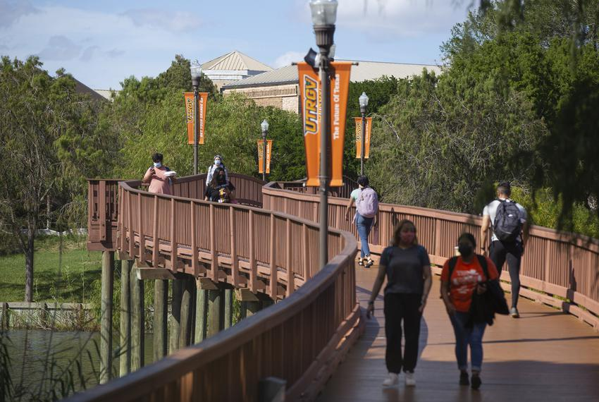 Students walk through a bridge connecting two sides of campus at the University of Texas at Rio Grande Valley on Oct. 19, 20…