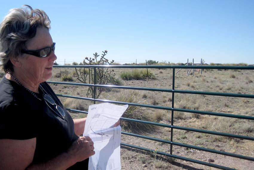 Malinda Beeman displays a map of the area where Tessera Solar plans to install 1,080 solar discs here to generate power fo...