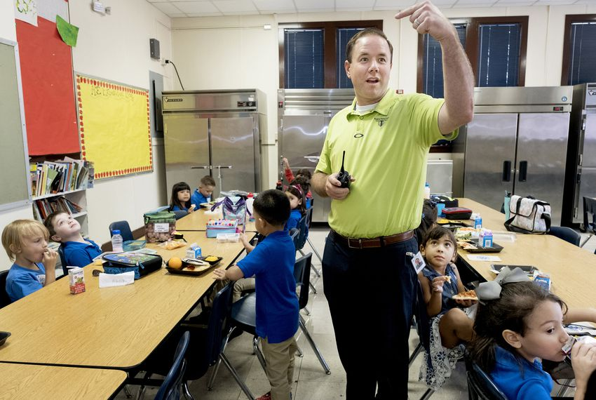 Brian Sparks is the principal at Lamar Elementary School in San Antonio. He helps out with cafeteria duties on the first day of school.