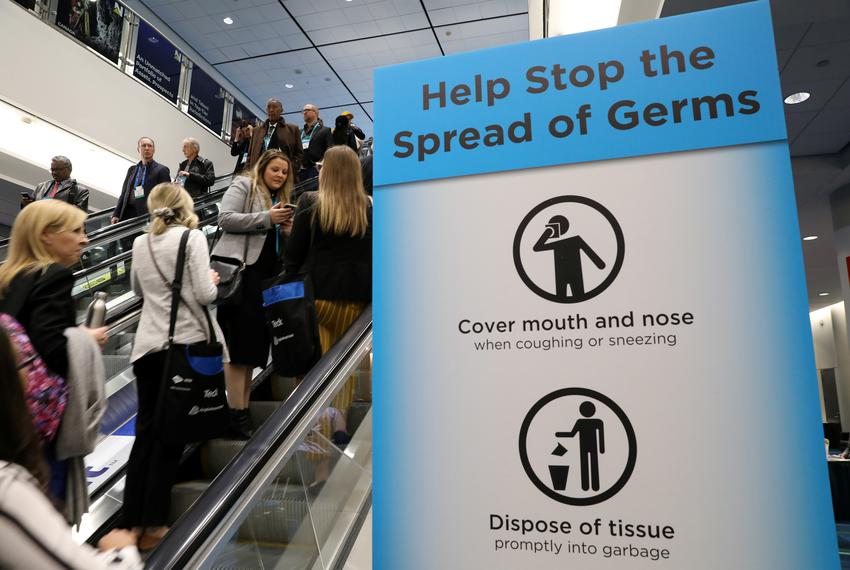 Visitors pass a sign warning about the spread of germs, after another case of the COVID-19 was confirmed in Toronto, Canada.…