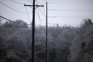 Electric power lines with ice on them in South Austin on Feb. 17, 2021.