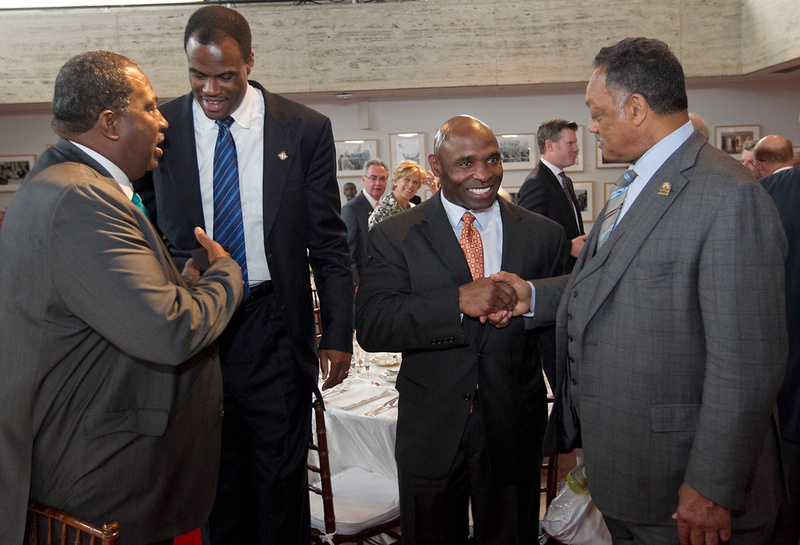 From L-R; State Sen. Royce West, D-Dallas; former NBA Hall of Famer David Robinson; Texas head football coach Charlie Strong and Rev. Jesse Jackson gather as they attend a dinner and speech by former President George W. Bush at the LBJ Library Atrium on April 10, 2014. 