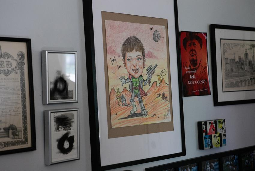 An old caricature of Joseph Pintucci hangs on the entry way wall in his parents house in Highland Park. He was killed in Jan…