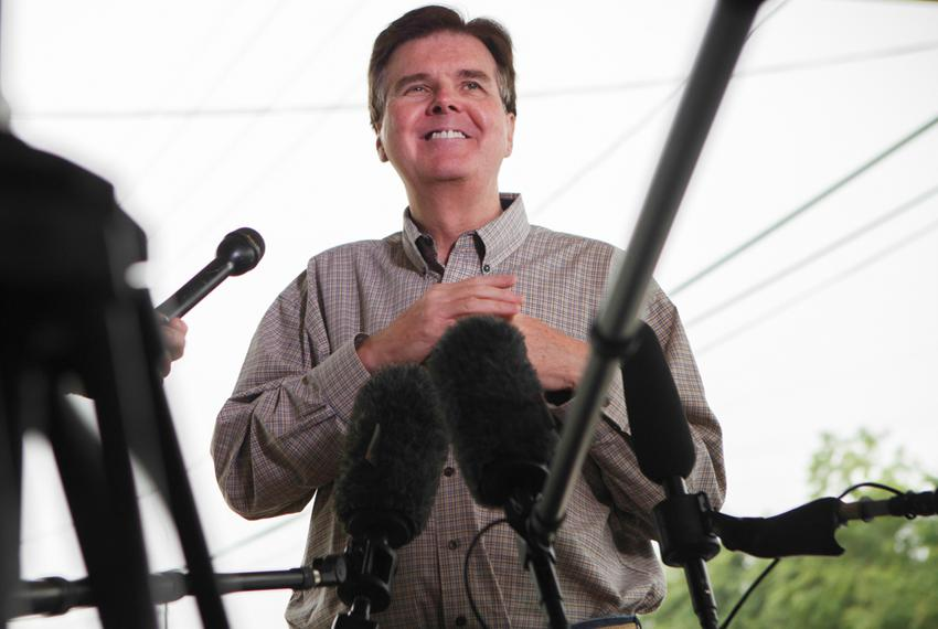 Republican State Sen. Dan Patrick chats with reporters at a polling station in Cypress, Texas Tuesday, May 27, 2014 to stu...
