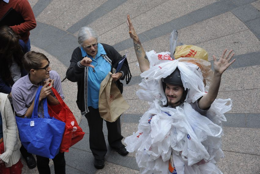 """An environmentalist dressed as a """"bag monster"""" protests HB 2416 on March 20, 2013 by State Rep. Drew Springer, R-Muenster, banning local bag ordinances."""