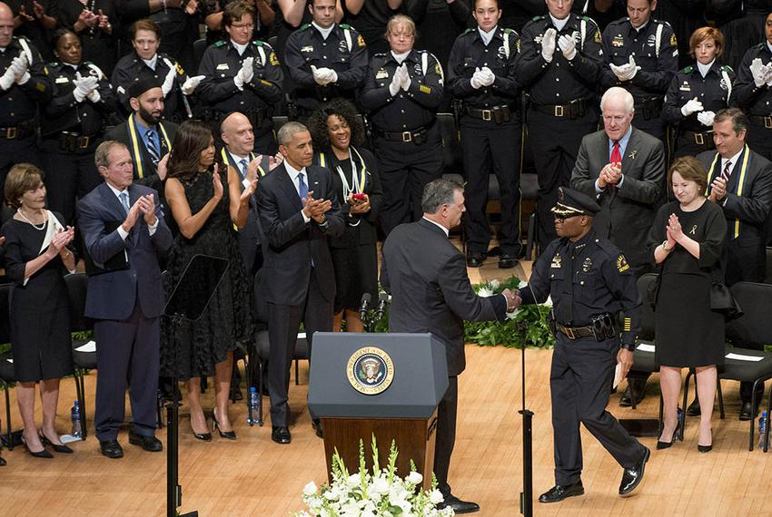 Dallas Mayor Mike Rawlings shakes Chief of Police David Brown's hand as former President Bush, President Obama, their wives,…