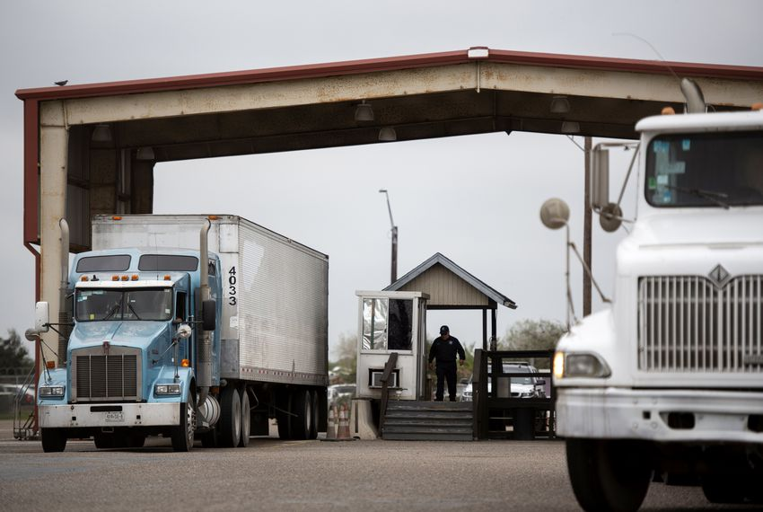 Trucks go through a secondary inspection after crossing the United States border via the Veterans International Bridge.