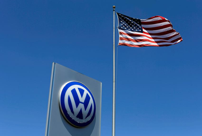 A U.S. flag flutters in the wind above a Volkswagen dealership in Carlsbad, California, U.S. May 2, 2016.