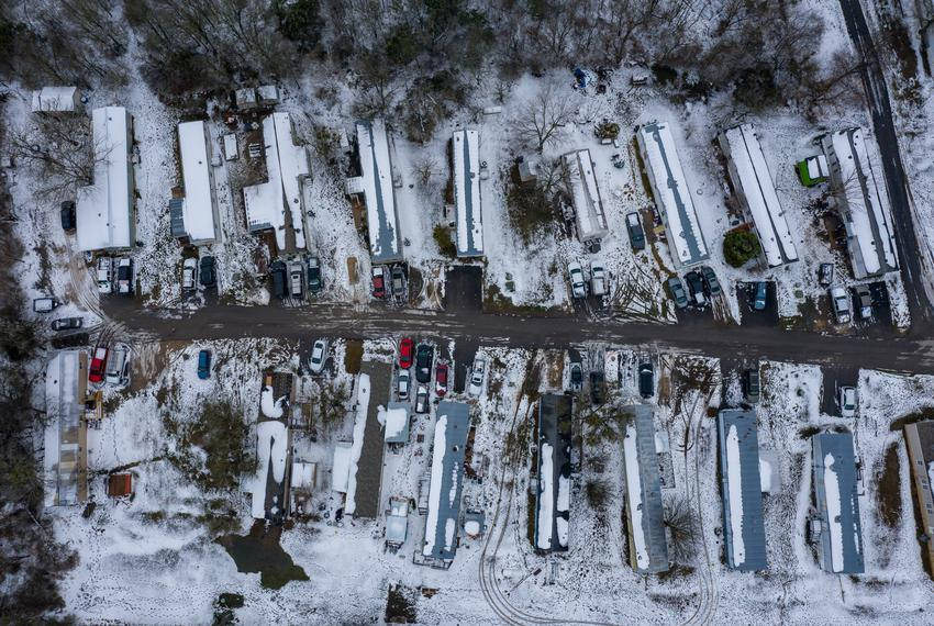 A mobile home park is covered with snow as a massive winter storm continues to engulf  Texas, causing widespread power and w…