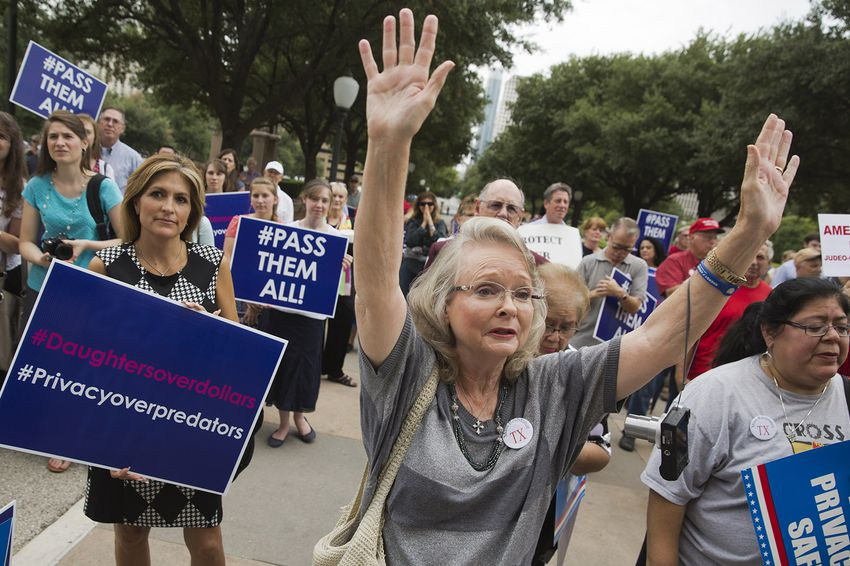 Supporters of the bathroom bill join pastors at a rally at the state Capitol on August 3, 2017.