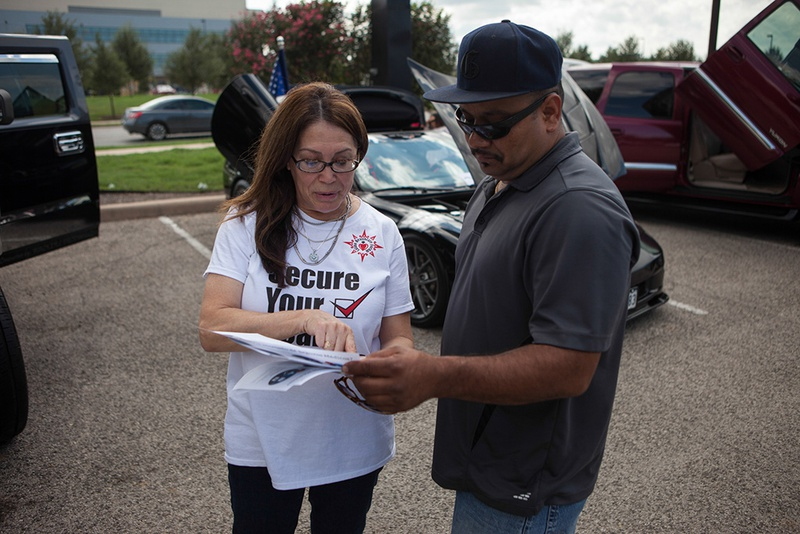 Jill Ramirez, the director of outreach for the Latino Healthcare Forum, passes out flyers and explains components of the Affordable Care Act on Oct. 5, 2013.