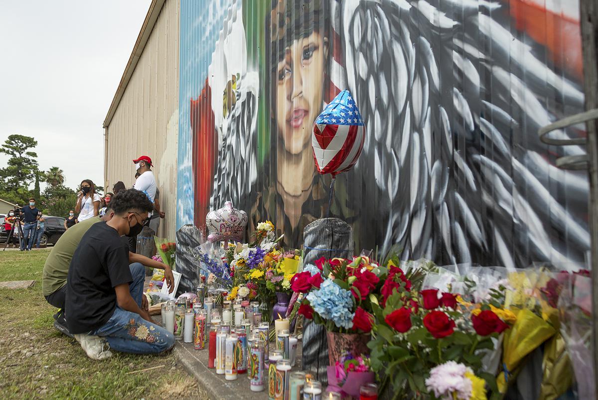 Juan Cruz kneels in front of a mural honoring his girlfriend, Army Specialist Vanessa Guillén, on Sunday, July 5, 2020.