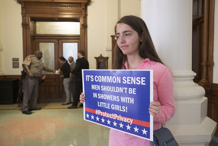 "Victoria Hendrix of Austin is one of two people outside the Senate chamber on July 25, 2017, in support of Senate Bill 3, the ""bathroom bill,"" up for debate during the special legislative session."