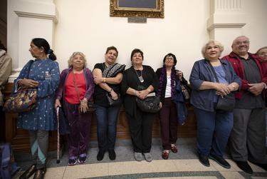 Left to right: Farhat Chishey, Julia Alderede, Kathy Medrano, Juanita Belt, Carmen Rodriguez, Hardy Melchorn, Vera Gomez and Robert Gomez wait in line to enter the House chamber.